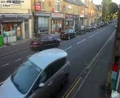 An off-road biker pulls a wheelie as they speed down Mosborough High Street.